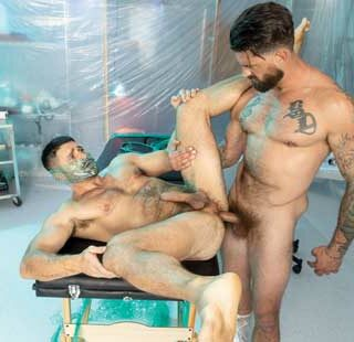 Beau Butler is bent over,restrained,and 'Wrapped' to a medical table withplasticwrap. Alpha Wolfe stands in front of Beau, feeding the bound stud his throbbing cock and tight ass.