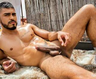 """Some fun in the sun with Hot AF Colombian Valentino Sistor. The semi-hairy defined Latino strokes his 7"""" cut cock outside and cools off with a spray of the water hose before releasing his delicious juice."""
