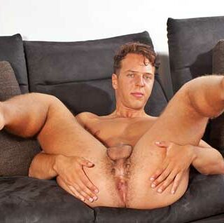 Leon Lovric is aged 22 and he lives in Prague. He is a student who enjoys sports, football and volleyball. Sitting on the sofa he looks good as he does his interview.